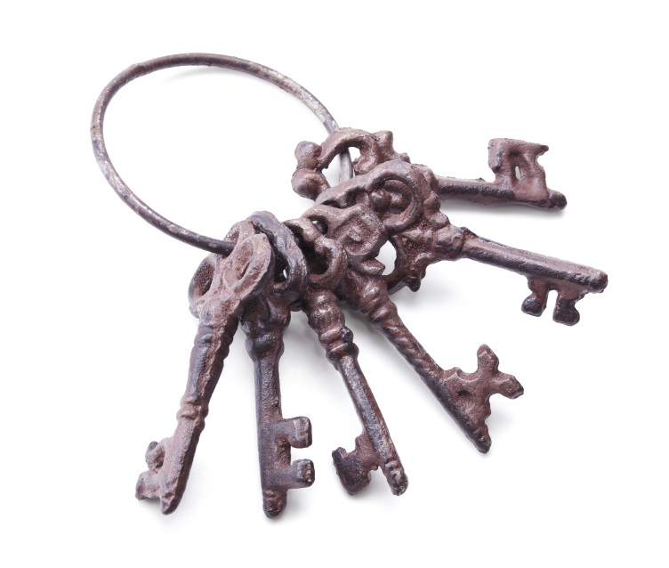 bunch of antique keys isolated on white